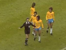 Referee Clive Thomas blows for time before Brazil score v Sweden